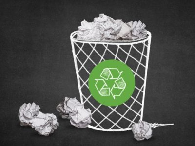 trash-with-paper-balls-recycling-symbol_1205-328